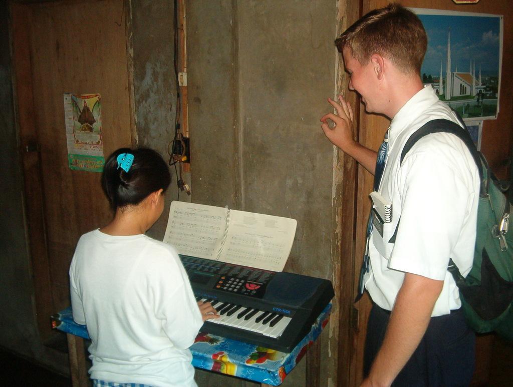 Irene Pulido, Elder M Cox, Teaching Piano Lessons