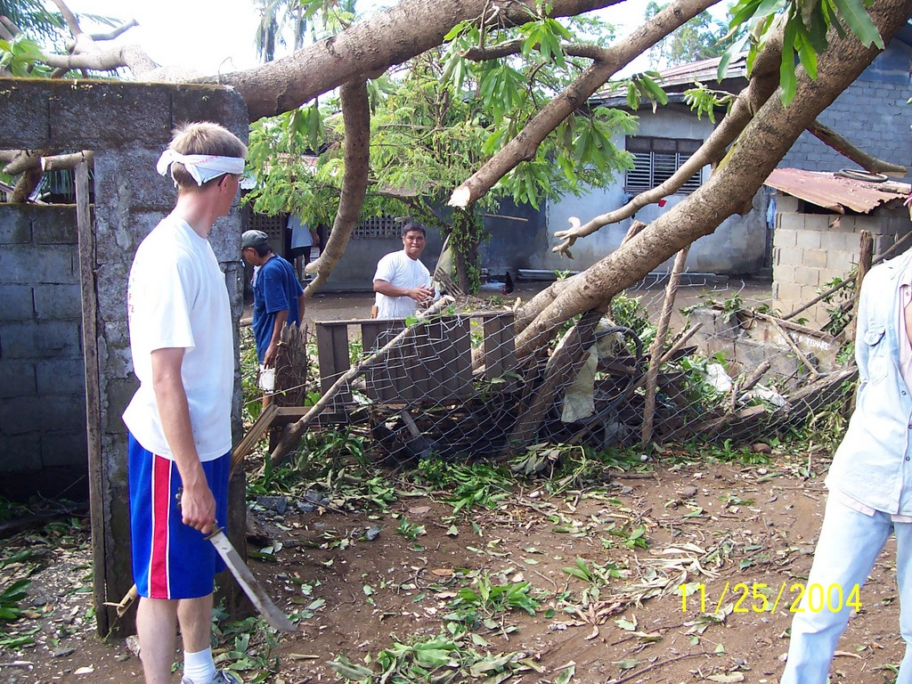 Me, Bro Andales, Pres Isla, working on cutting down the tree