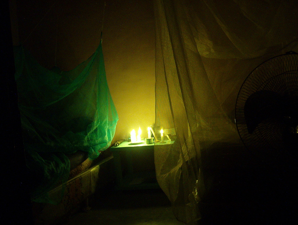 This is what our bedroom looked like during a brown-out. We had a stack of candles on the bed-side table so we could see a bit in the dark.