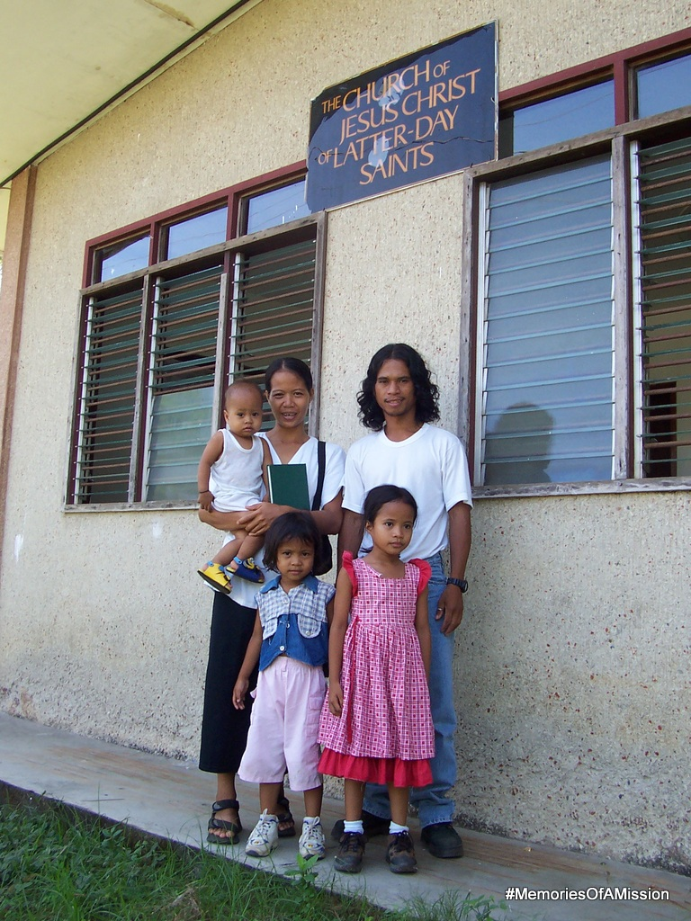 The Viloria Family in front of the church