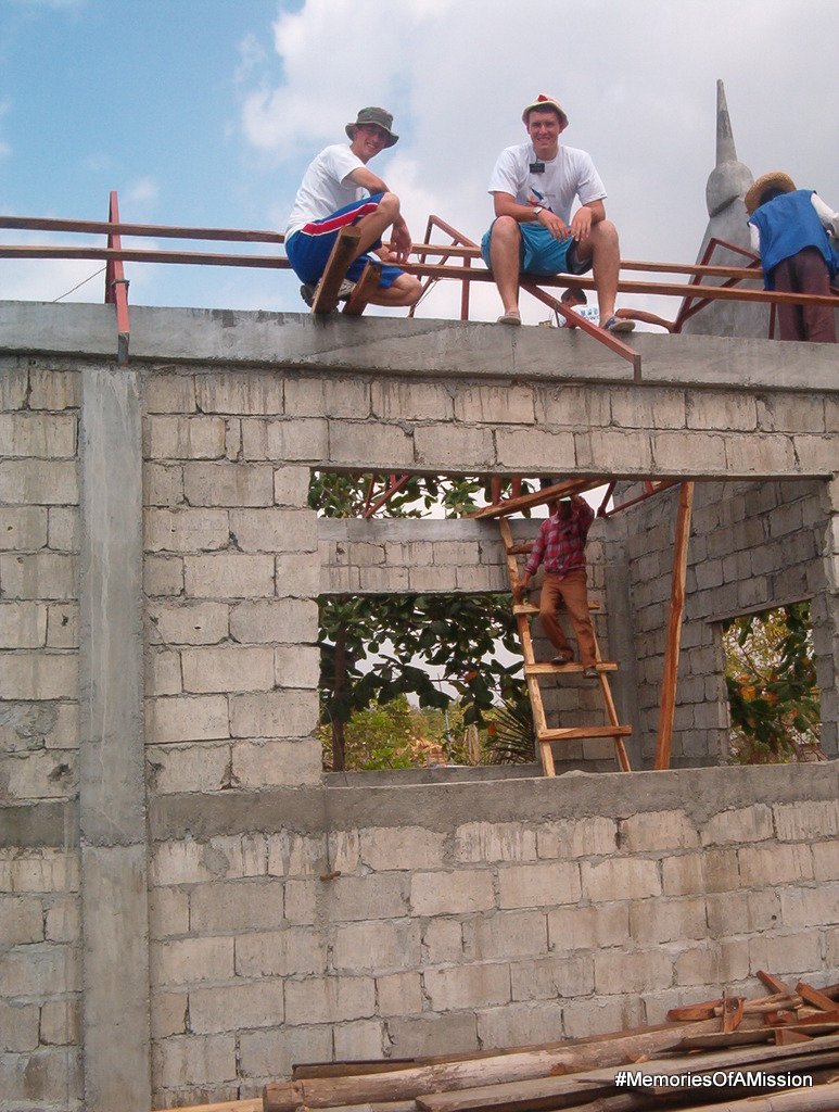 Elder Arnesen and Elder Zack Cox on the roof of the church we helped to build.